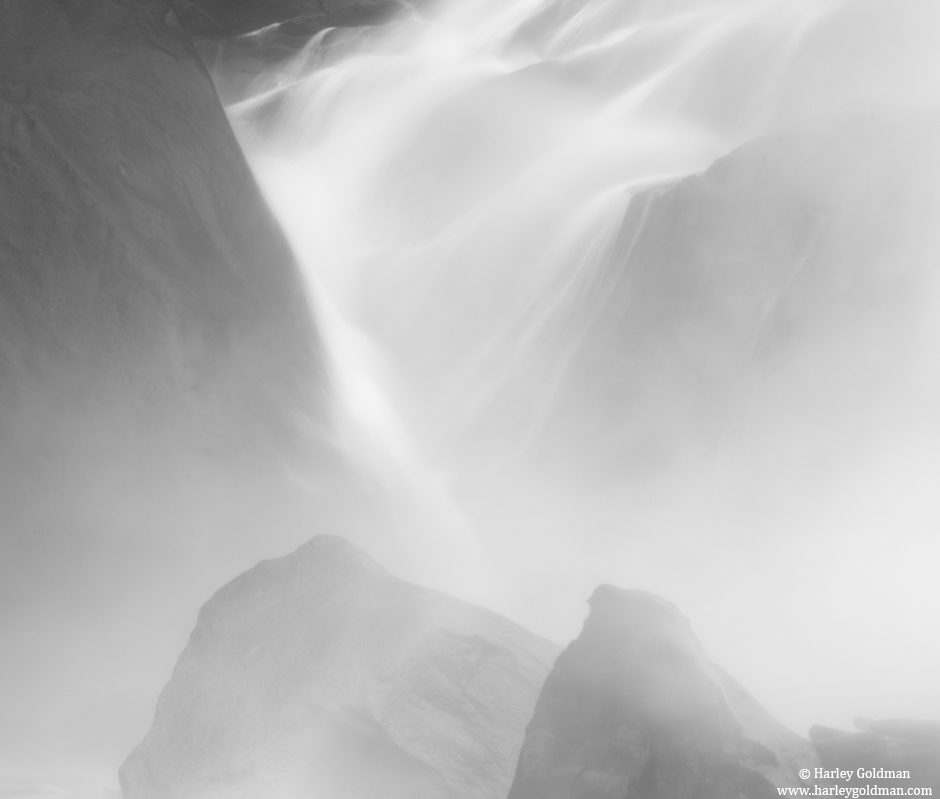 Mist obscures at the bottom of a thundering Vernal Falls          &...